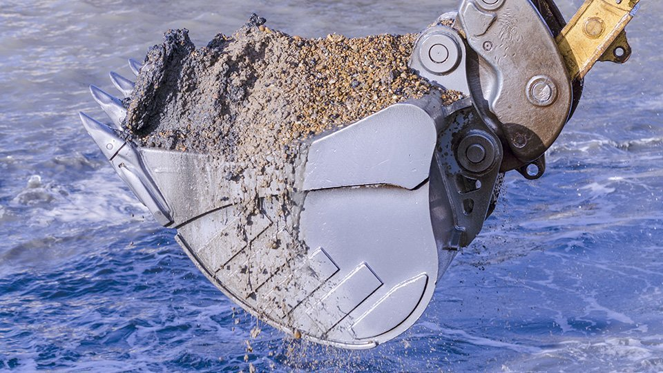 Bucket filled with soil and sand after underwater cleaning